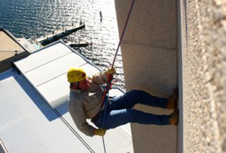 Headmaster Warwick Dean abseiling from the top of Wrest Point Casino.