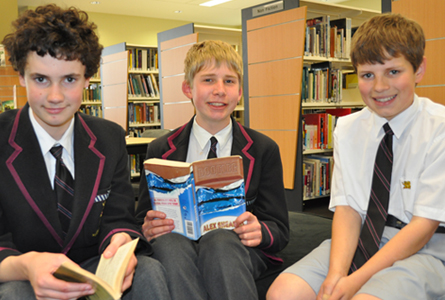 Middle School students Max McLaughlin, Johnathon Clark-Hansen and Stuart Carnaby practise their prose performances in the Nettlefold Library.