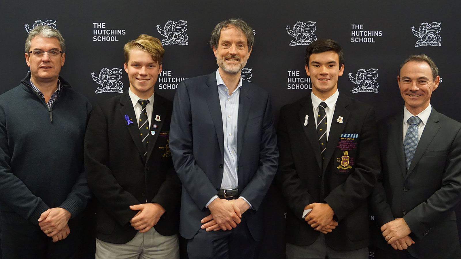 L–R Mr Gene Phair (Chairman of the Board), Alex Hogan-Jones (School Vice-Captain), Professor Rufus Black, Oliver Burrows-Cheng (School Captain), Dr Rob McEwan (Headmaster).