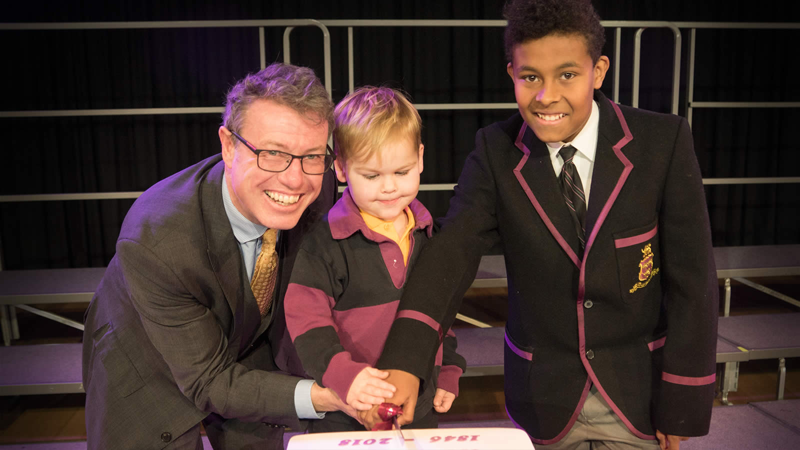 President of the Hutchins School Old Boys Association Mr Tim Munro ('82) with Edward Berry (Pre-Kindergarten) and Austin Douglas (Year 6).