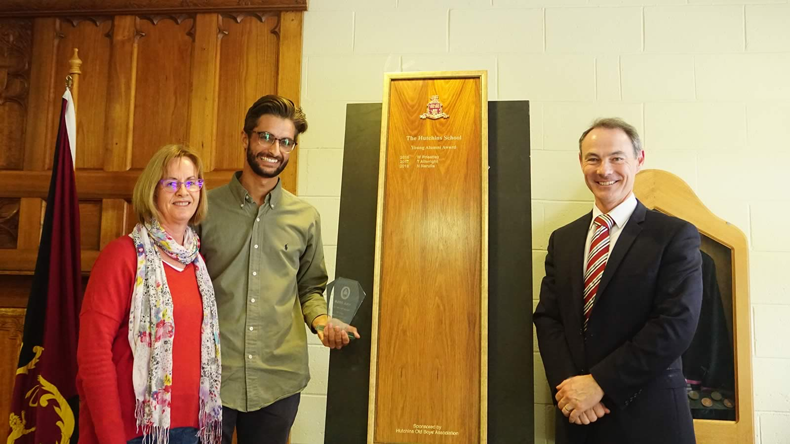 Nanak Narulla ('11) receiving the HSOBA Young Alumni Award with mother Sally Brown and Dr Rob McEwan.