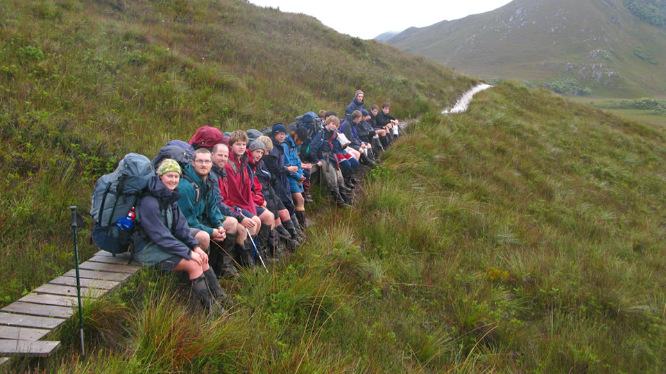 Walkers take a break on the way to Melaleuca from Cox's Bight.