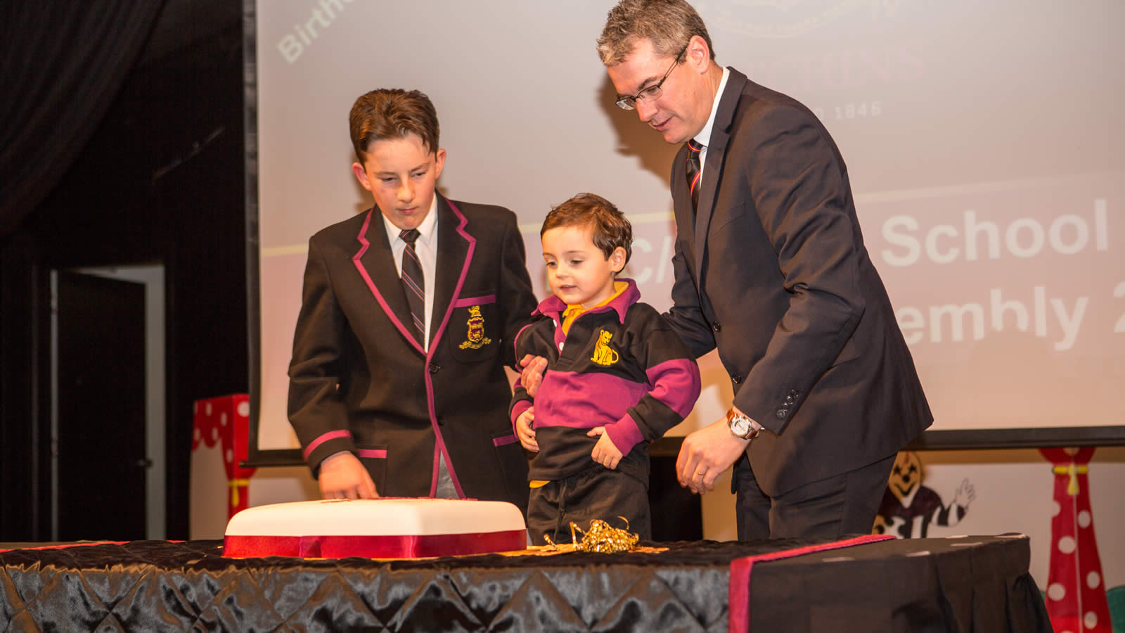 Lloyd Lucas, Aleksandar Stanojevic and Mr Gene Phair cutting the Anniversary Cake. (large)