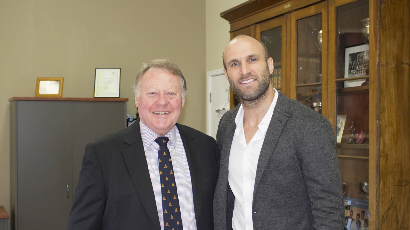 Mr Warwick Dean, Headmaster, with dual Brownlow medallist, Chris Judd (large)