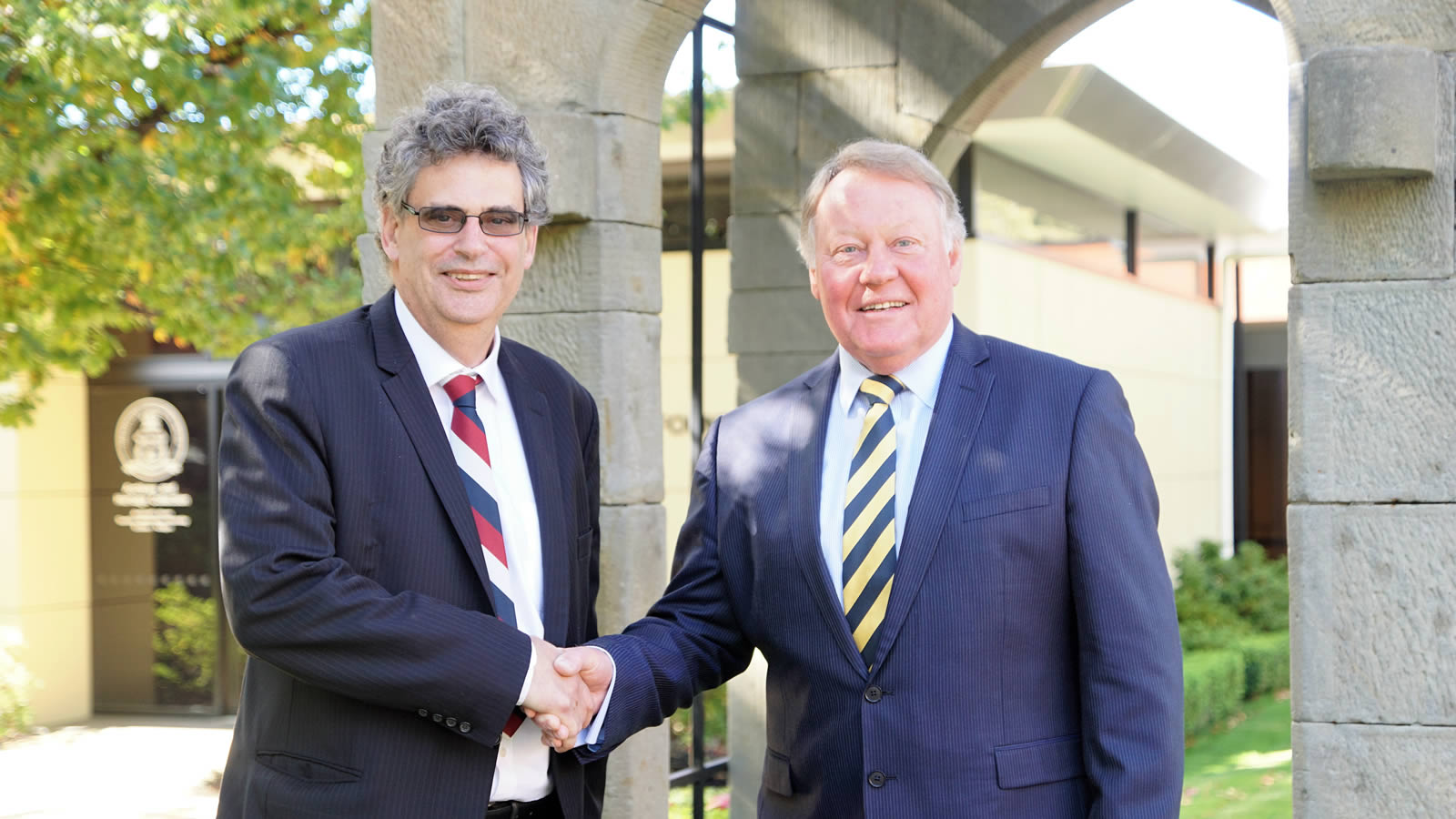 Chairman of The Hutchins School Board, Professor Marcus Haward congratulates Headmaster, Mr Warwick Dean on the announcement of his retirement (large)