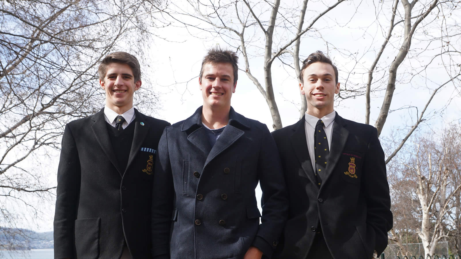 Tom is pictured with Year 12 students Angus Calvert and Michael Young.