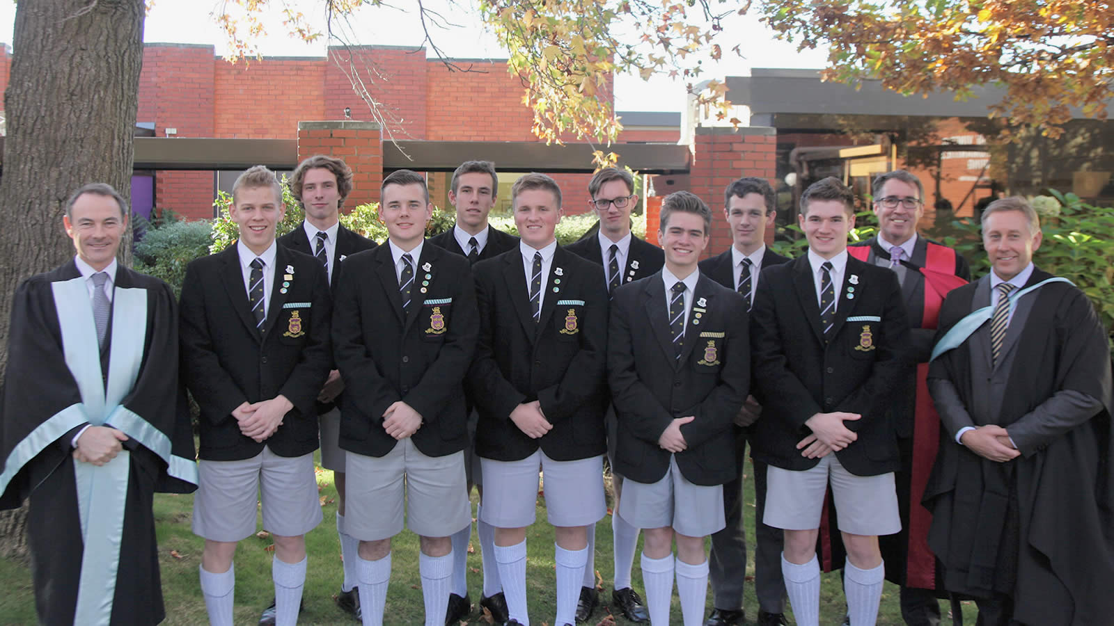 Dr Rob McEwan (Headmaster), Dr Adam Forsyth (Deputy Headmaster) and Mr Roger McNamara (Head of Senior School) with the newly inducted Prefects.