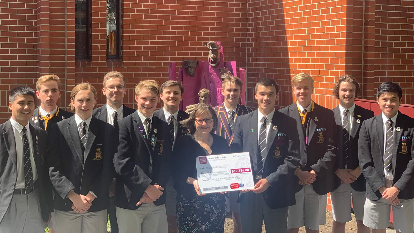 Year 12 students with Lesley Mackay, Tasmanian General Manager of The Smith Family.